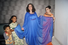 My mom modeling her dress that my host mom lent her (with the help of Abigail, Rayan and Tariq)